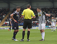 Referee Craig Thomson has words with Stuart Kettlewell (left) and John McGinn (right) in the St Mirren v Ross County Scottish Professional Football League Premiership match played at St Mirren Park, Paisley on 3.5.14.