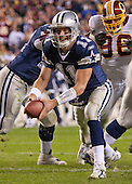 Dallas Cowboy quarterback Drew Bledsoe (11) looks to pitch the ball to a running back in second quarter action against the Washington Redskins at FedEx Field on December 18, 2005.  The Redskins won the game 35 - 7.<br /> Credit: Arnie Sachs / CNP