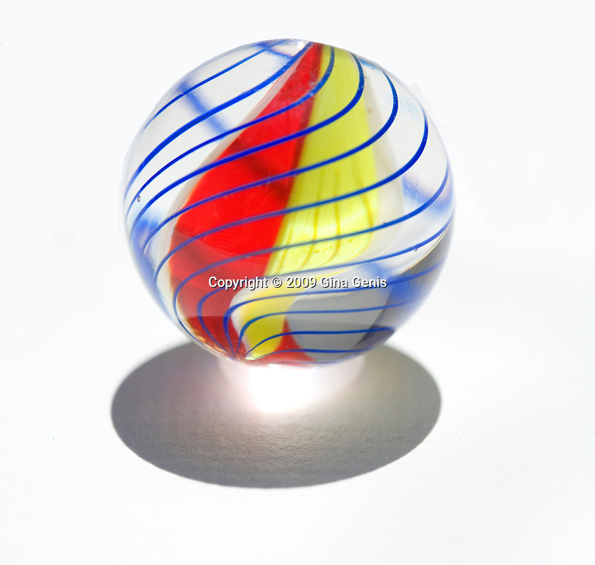 Colorful red, yellow, and blue glass marble