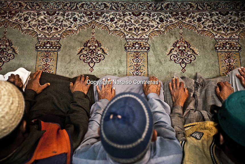 Kashmri muslim men praying at a Dastgir Saheb shrine of a sufi saint in Srinagar. Muslims around the world are attending the holy month of Ramadan, where they observe the devout fast from dawn to dusk.