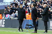 Tottenham Hotspur manager Mauricio Pochettino queries a decision with Leicester City manager Claude Puel and fourth official Lee Mason during Tottenham Hotspur vs Leicester City, Premier League Football at Wembley Stadium on 10th February 2019