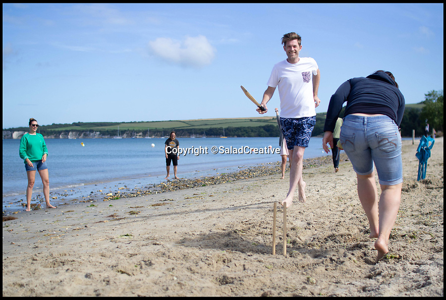 BNPS.co.uk (01202 558833)<br /> Pic:     SaladCreative/BNPS<br /> <br /> June 2019 - Summer beach party, Studland, Dorset.<br /> <br /> Britain's 'best boss' has once again gone out of her way to treat her staff - by throwing a summer party.<br /> <br /> Arabella Lewis-Smith, 43, earned the title after taking her 20 staff on an all expenses paid trip to Madrid for a three day Christmas party, covering the £5,000 bill.<br /> <br /> Now, the founder of Salad Creative, a marketing agency, has further endeared herself to them by putting on a special day out on the idyllic Dorset coast.<br /> <br /> Things kicked off with a lively pub lunch, then the group meandered their way down to Knoll Beach in Studland for an afternoon picnic.