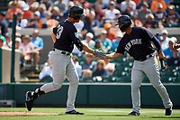 New York Yankees designated hitter Greg Bird (33) is congratulated by Gleyber Torres (25) as he returns to the dugout after hitting a home run in the top of the first inning during a Grapefruit League Spring Training game against the Detroit Tigers on February 27, 2019 at Publix Field at Joker Marchant Stadium in Lakeland, Florida.  Yankees defeated the Tigers 10-4 as the game was called after the sixth inning due to rain.  (Mike Janes/Four Seam Images)