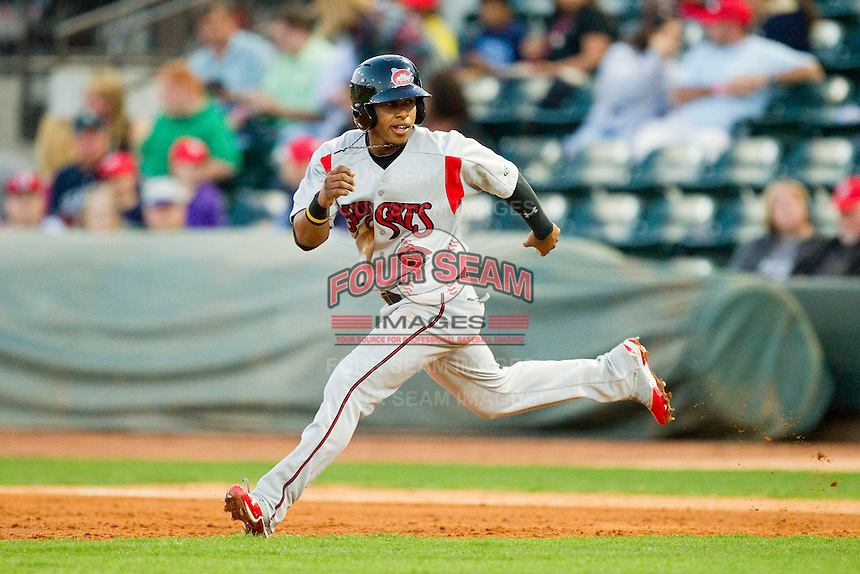 Francisco Lindor (12) of the Carolina Mudcats takes his lead off of first base against the Winston-Salem Dash at BB&T Ballpark on April 13, 2013 in Winston-Salem, North Carolina.  The Dash defeated the Mudcats 4-1.  (Brian Westerholt/Four Seam Images)