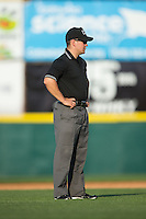 Umpire Chris Scott handles the calls on the bases during the South Atlantic League game between the Greensboro Grasshoppers and the Hickory Crawdads at L.P. Frans Stadium on May 6, 2015 in Hickory, North Carolina.  The Crawdads defeated the Grasshoppers 1-0.  (Brian Westerholt/Four Seam Images)