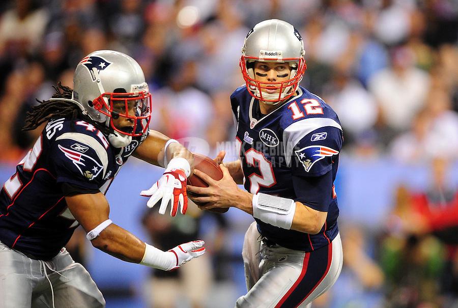 Feb 5, 2012; Indianapolis, IN, USA; New England Patriots quarterback Tom Brady (12) fakes a hand off to running back BenJarvus Green-Ellis (42) during the second half of Super Bowl XLVI against the New York Giants at Lucas Oil Stadium.  Mandatory Credit: Mark J. Rebilas-