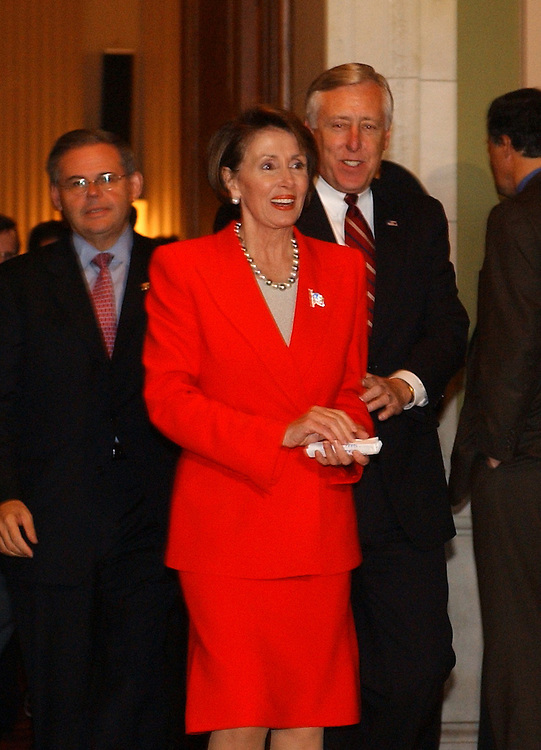 dems7/111402 -- Reps. Bob Menedez, D-N.J., newly elected Chairman of the Democratic Caucus,  House Minority Leader Nancy Pelosi, D-Calif.,and Rep Steny Hoyer, new House Minority Whip, walk to a news conference after the Democratic Leadership elections, Thursday.