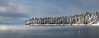 The is a view of the mist on Agate Bay on the North Shore of Lake Tahoe after a major Christmas Eve snow storm.