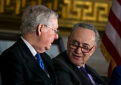 Senate Majority Leader Mitch McConnell, a Republican from Kentucky, and Senate Minority Leader Chuck Schumer, a Democrat from New York, speak during a congressional Gold Medal ceremony for former Senator Bob Dole, in Washington D.C., U.S., on Wednesday, Jan. 17, 2018. Photographer: Al Drago/Bloomberg<br /> Credit: Al Drago / Pool via CNP