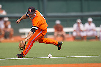 Oklahoma State Cowboys second baseman Tim Arakawa #2 lunges to field a ground ball during the NCAA baseball game against the Texas Longhorns on April 26, 2014 at UFCU Disch–Falk Field in Austin, Texas. The Cowboys defeated the Longhorns 2-1. (Andrew Woolley/Four Seam Images)