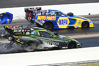 Sep 4, 2017; Clermont, IN, USA; NHRA funny car driver Alexis DeJoria (near) races alongside Ron Capps during the US Nationals at Lucas Oil Raceway. Mandatory Credit: Mark J. Rebilas-USA TODAY Sports