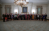 United States President Donald J. Trump and First lady Melania Trump participates in a photo op with senior military leaders and their spouses in the State Dining Room of the White House in Washington, DC on Monday, October 7, 2019.<br /> Credit: Ron Sachs / Pool via CNP