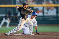 Coastal Carolina Chanticleers shortstop Michael Paez (1) turns a double play Florida Gators baserunner J.J. Schwarz (22) slides into the bag in Game 4 of the NCAA College World Series on June 19, 2016 at TD Ameritrade Park in Omaha, Nebraska. Coastal Carolina defeated Florida 2-1. (Andrew Woolley/Four Seam Images)