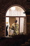 © Joel Goodman - 07973 332324 . No syndication permitted . 28/11/2013 . Manchester , UK . A man in army fatigues leaves the house with bags . Scene at 17 Mellor Street in Eccles , Greater Manchester this evening (Thursday 28th November 2013) where police have cordoned off adjoining streets and evacuated houses following the discovery of a suspicious device .  Photo credit : Joel Goodman