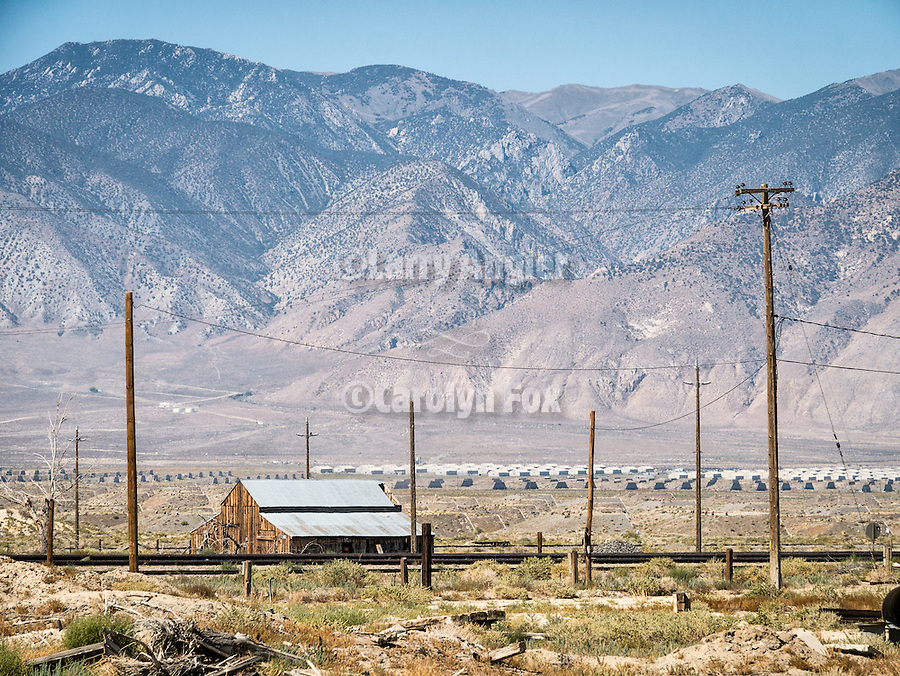 Hawthorne Army Depot bunkers, barn and power poles, Hawthorne, Nevada