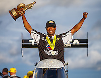 Aug 20, 2016; Brainerd, MN, USA; NHRA top fuel driver Antron Brown celebrates after winning the Protect the Harvest Nationals from Seattle, WA that was delayed by rain to run during qualifying for the Lucas Oil Nationals at Brainerd International Raceway. Mandatory Credit: Mark J. Rebilas-USA TODAY Sports