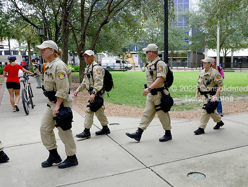 State Troopers patrol the streets near the park where protests are allowed near the 2012 Republican National Convention in Tampa Bay, Florida on Saturday, August 25, 2012..Credit: Ron Sachs / CNP.(RESTRICTION: NO New York or New Jersey Newspapers or newspapers within a 75 mile radius of New York City)