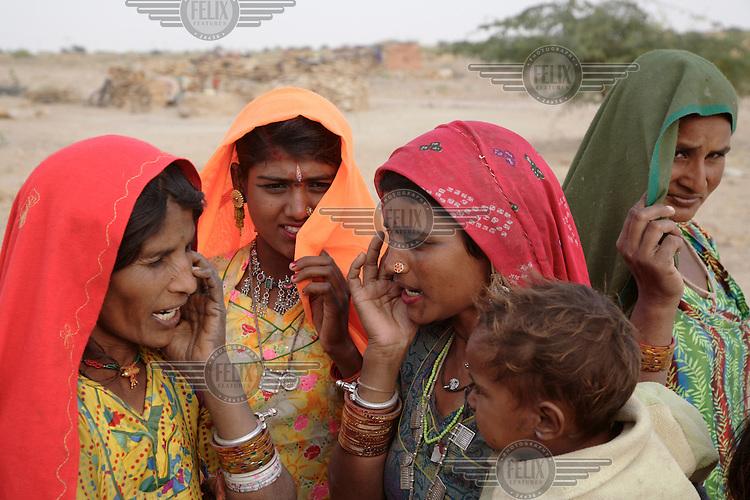 Women sing traditional songs to bring rain to their drought stricken villages near Jaisalmer...