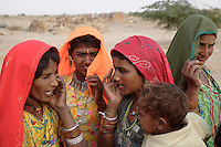 Women sing traditional songs to bring rain to their drought stricken villages near Jaisalmer...
