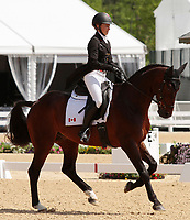 LEXINGTON, KY - April 27, 2017. #34 Pavarotti and Jessica Phoenix from Canada finish in 1st place on day 1 of Dressage at the Rolex Three Day Event at the Kentucky Horse Park.  Lexington, Kentucky. (Photo by Candice Chavez/Eclipse Sportswire/Getty Images)