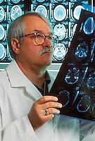 Docter reviews patient MRI.