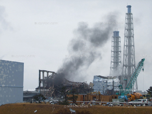 December 26, 2011, Tokyo, Japan - A column of black smoke rises from the damaged No. 4 reactor building at Fukushima No. 1 nuclear power plant in Okumamamchi, Fukushima prefecture, some 210km northeast of Tokyo, on March 21, 2011, in this file photo released by the plant operator. Tokyo Electric Power Co., the operator of the crippled plant, and its regulators were so unprepared for a major nuclear emergency that they lacked even the basic safety measures to respond to a disaster of the scale that hit the power plant in the wake of the March 11 tsunami, an independent committee probing the nuclear crisis stated Monday, December 26, 2011, in the interim report of its findings following about six months of investigation. The committee of 10 independent experts, commissioned by the government, also cited insufficient information gathering and poor communication among those in the government, the regulators and at the company as major factors that worsened the situation. (Photo by TEPCO/AFLO) [0006] -mis-