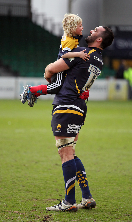 Worcester Warriors Jonathan Thomas with his son<br /> <br /> Photographer Rachel Holborn/CameraSport<br /> <br /> Rugby Union - Greene King IPA Championship  - Worcester Warriors v London Scottish - Saturday 28th March 2015 - Sixways Stadium - Worcester<br /> <br /> &copy; CameraSport - 43 Linden Ave. Countesthorpe. Leicester. England. LE8 5PG - Tel: +44 (0) 116 277 4147 - admin@camerasport.com - www.camerasport.com