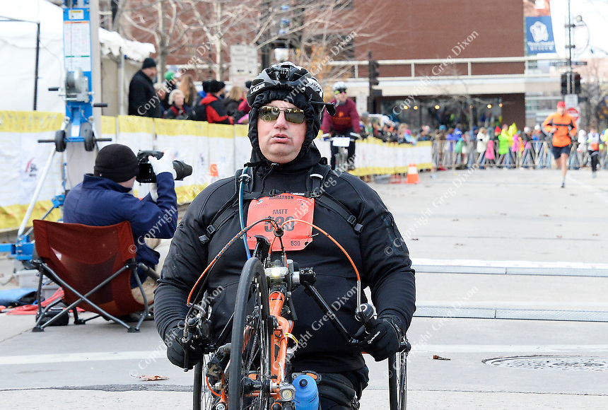 Matt Glowacki catches his breath after winning the Wheelchair Full Marathon during the Madison Marathon on Sunday in Madison