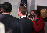 Surrounded by staff and security, Mark Zuckerberg, Co-Founder and Chief Executive Officer of Facebook, walks away from United States Senator Dianne Feinstein's (Democrat of California) office as he makes the rounds on Capitol Hill prior to giving testimony before Congress on Tuesday and Wednesday on Monday, April 9, 2018<br /> CAP/MPI/RS<br /> &copy;RS/MPI/Capital Pictures