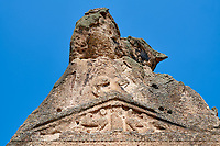 Close up of two sphinxes relief scul[ptures of the Phrygian temple of Aslankaya, 7th century BC. Phyrigian Valley, Emre Lake, near Doger, Turkey.<br />