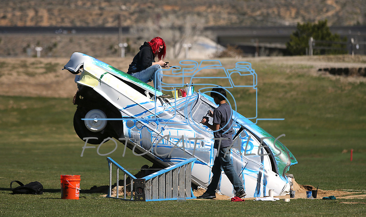 Doral Red Rock Academy students, Adela Del Rivero, and Denzel Barabaran, both 15, paint Cadillacs at the driving range at the Silver Oak Golf Course, in Carson City, Nev., on Sunday, April 8, 2018. The Las Vegas art students' work was a Carson City history theme. <br />