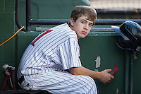 Kannapolis Intimidators bat boy Allan Westerholt checks the radar on his smart phone to see if he will have to help pull the tarp on the field during the game against the Delmarva Shorebirds at Kannapolis Intimidators Stadium on June 23, 2016 in Kannapolis, North Carolina.  The game was suspended in the bottom of the 4th inning due to rain.  (Brian Westerholt/Four Seam Images)
