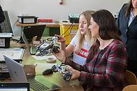 """Die Berliner Bildungssenatorin Sandra Scheeres eroeffnet am Montag den 19. Maerz 2018 zusammen mit Thorsten Leimbach vom Fraunhofer-Institut fuer Intelligente Analyse- und Informationssysteme IAIS und Sabine Frank von Google Deutschland den ersten Coding Hub fuer Berliner Schulen. Der Coding Hub ist als Teil des Leitprojektes """"Calliope - Open Roberta"""" des eEducation Berlin Masterplans das erste von fuenf Coding Hubs in Berlin.<br /> Ziel ist, Kinder und Jugendliche ab der 3. Klasse in ausserschulischen Lernorten fuer Technik zu begeistern sowie grundlegende Kenntnisse in Informatik und Programmieren zu vermitteln. Das Berliner Start-Up Calliope stellt hierfuer den Coding Hubs mit einer Foerderung von Google Mini-Computer zur Verfuegung. Das Fraunhofer IAIS bildet dazu die Mitarbeiterinnen und Mitarbeiter der Coding Hubs fort, stellt Notebooks und LEGO EV3 Roboter als weitere Hardware zur Verfuegung. Das Fraunhofer IAIS plant die Eroeffnung von bundesweit 30 Coding Hubs fuer Jugendliche.<br /> Im Bild vlnr: Die Schuelerin Charlize erklaert Bildungssenatorin Sandra Scheeres die Programmierung eines Roboters die sie geschrieben habt.<br /> 19.3.2018, Berlin<br /> Copyright: Christian-Ditsch.de<br /> [Inhaltsveraendernde Manipulation des Fotos nur nach ausdruecklicher Genehmigung des Fotografen. Vereinbarungen ueber Abtretung von Persoenlichkeitsrechten/Model Release der abgebildeten Person/Personen liegen nicht vor. NO MODEL RELEASE! Nur fuer Redaktionelle Zwecke. Don't publish without copyright Christian-Ditsch.de, Veroeffentlichung nur mit Fotografennennung, sowie gegen Honorar, MwSt. und Beleg. Konto: I N G - D i B a, IBAN DE58500105175400192269, BIC INGDDEFFXXX, Kontakt: post@christian-ditsch.de<br /> Bei der Bearbeitung der Dateiinformationen darf die Urheberkennzeichnung in den EXIF- und  IPTC-Daten nicht entfernt werden, diese sind in digitalen Medien nach §95c UrhG rechtlich geschuetzt. Der Urhebervermerk wird gemaess §13 UrhG verlangt.]"""