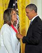 United States President Barack Obama presents the 2012 National Medal of Humanities to Anna Deavere Smith during a ceremony in the East Room of the White House in Washington, D.C.  on Wednesday, July 10, 2013.<br /> Credit: Ron Sachs / CNP
