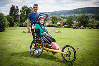 COPY BY TOM BEDFORD<br /> Pictured: Poppy Jones and her dad Rob with the special bicycle for the triathlon.<br /> Re: A very special father-and-daughter team have tackled the Cardiff Triathlon on Sunday 26 June 2016.<br /> Poppy Jones, 11, who will be competing alongside dad Rob Jones, wants to win the event.<br /> And she's not going to let the fact that she has quadriplegic cerebral palsy , which means she can't sit, stand, roll or support herself, and chronic lung disease stop her.<br /> She will be by Rob's side every step of the way thanks to a cutting-edge wheelchair and boat – for Rob to push or pull – designed especially for the event, which sees participants take part in a swim across Cardiff Bay , a run and a bike ride.