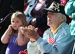 Braelyn Rhodes, 6, left, and Dick Beaudette, who served in the U.S. Army Infantry, watch the annual Veterans Day parade in Virginia City, Nev., on Monday, Nov. 11, 2013.<br /> Photo by Cathleen Allison