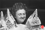 December 3, 1993 - Marie Buonocore of Waterbury, a member of St. Michael's Church in Waterbury, has a look at some of the gingerbread churches that will be on sale along with gingerbread houses during the church's annual Christmas bazaar.  The event will be Saturday from 10 a.m. to 7 p.m. and Sunday from 8:30 a.m. to 1 p.m. The churches are wrapped in plastic for protection.