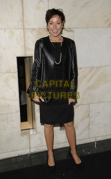Amanda Mealing .The Women Of The Year Lunch, Intercontinental hotel, Park Lane, London, England..October 17th, 2011.full length black dress leather jacket clutch bag pearl necklace .CAP/CAN.©Can Nguyen/Capital Pictures.