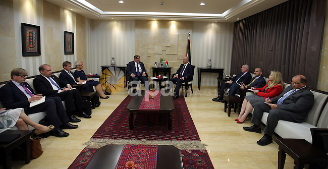 Palestinian Prime Minister Rami Hamdallah meets with a Finish Foreign Minister Timo Soini, in the West Bank city of Ramallah, on June  2, 2016. Photo by Prime Minister Office