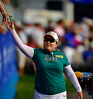 Inbee Park of Korea makes her way to the 18th green while walking down the Walk of Champions. Inbee Park of Korea, Pernilla Lindberg of Sweden, and Jennifer Song of the United States played multiple playoff holes until play was suspended due to darkness during the final round of the ANA Inspiration at the Mission Hills Country Club in Palm Desert, California, USA. 4/1/18.<br /> <br /> Picture: Golffile | Bruce Sherwood<br /> <br /> <br /> All photo usage must carry mandatory copyright credit (&copy; Golffile | Bruce Sherwood)