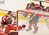 Vanessa Emond (SLU - 14) and Ellie Williams (SLU - 24) celebrate Williams' goal. - The Boston College Eagles defeated the visiting St. Lawrence University Saints 6-3 (EN) in their NCAA Quarterfinal match on Saturday, March 10, 2012, at Kelley Rink in Conte Forum in Chestnut Hill, Massachusetts.