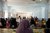 Women arrive at the school in Al Saf village for a meeting organized by the Muslim Sisters. Egypt, June 2012.