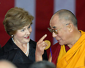 Washington, DC - October 17, 2007 -- The 14th Dalai Lama, Tenzin Gyatso, right, discusses his Congressional Gold Medal with first lady Laura Bush, left, in Washington, D.C. on Wednesday, October 17, 2007.  The Dalai Lama was at The Capitol to accept the Congressional Gold Medal, the nation's highest and most distinguished civilian award..Credit: Ron Sachs/CNP