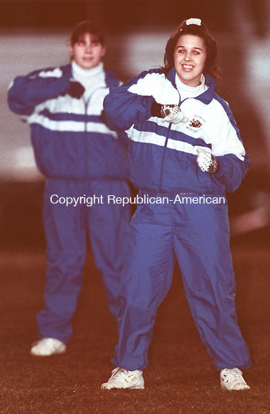 WATERBURY, CT 11/20/98--1120DC08.tif .Seymour High School cheerleaders Michelle Hoblack (R) and Erica Laudano (L) do thier half time show for the fans at the Seymour High and John F. Kennedy High School Naugatuck Valley League Championship game.-DOUG COLLIER staff photo (Filed in Scans/Scan-In)