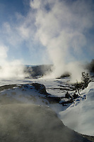 Steam rises from the Main Terrace for a dramatic winter sunrise-Mammoth Hot Springs