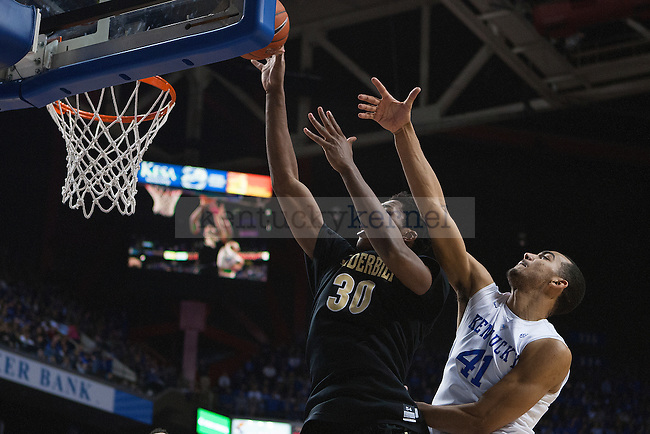 Forward Trey Lyles of the Kentucky Wildcats attempts to guard a shot during the game against the Vanderbilt Commodores at Rupp Arena on January 20, 2015 in Lexington, Kentucky. Kentucky defeated Vanderbilt 65-57. Photo by Taylor Pence
