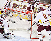 Michael Pereira (UMass - 7) celebrates as the puck gets behind Parker Milner (BC - 35), but the play was ruled no goal following video review. - The Boston College Eagles defeated the visiting University of Massachusetts-Amherst Minutemen 2-1 in the opening game of their 2012 Hockey East quarterfinal matchup on Friday, March 9, 2012, at Kelley Rink at Conte Forum in Chestnut Hill, Massachusetts.