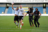 Jefferson Montero (right) and Oli McBurnie (left) of Swansea City celebrate at full time of the Sky Bet Championship match between Millwall and Swansea City at The Den in London, England. September 1, 2018