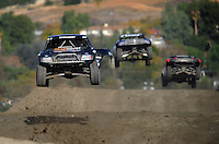 Dec. 18, 2009; Lake Elsinore, CA, USA; LOORRS unlimited two driver Michael Johnson (left) takes a jump during qualifying for the Lucas Oil Challenge Cup at the Lake Elsinore Motorsports Complex. Mandatory Credit: Mark J. Rebilas-US PRESSWIRE