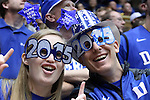 31 December 2014: Duke fans, two Cameron Crazies celebrating New Year's Eve. The Duke University Blue Devils hosted the Wofford College Terriers at Cameron Indoor Stadium in Durham, North Carolina in a 2014-16 NCAA Men's Basketball Division I game.